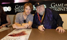 SAN DIEGO, CA - JULY 13:  Actor Alfie Allen (L) and writer George R.R. Martin sign autographs for HBO's