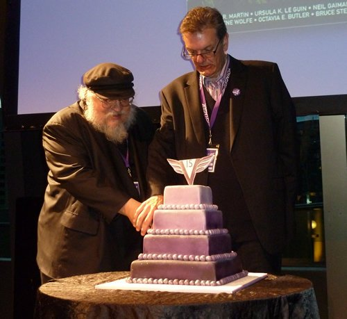 George and Michael Moynahan cut the Voyager 15 Birthday cake
