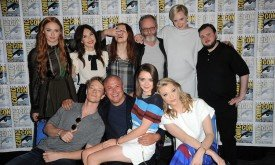 "SAN DIEGO, CA - JULY 10:  (L-R back row) Actors Sophie Turner, Carice van Houten, Hannah Murray, Liam Cunningham, Gwendoline Christie, and John Bradley; (L-R front row) Alfie Allen, Conleth Hill, Maisie Williams, and Natalie Dormer attend the ""Game of Thrones"" panel during Comic-Con International 2015 at the San Diego Convention Center on July 10, 2015 in San Diego, California.  (Photo by Albert L. Ortega/Getty Images)"