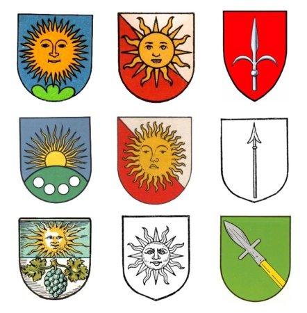 Примеры земных гербов с солнцем и копьем